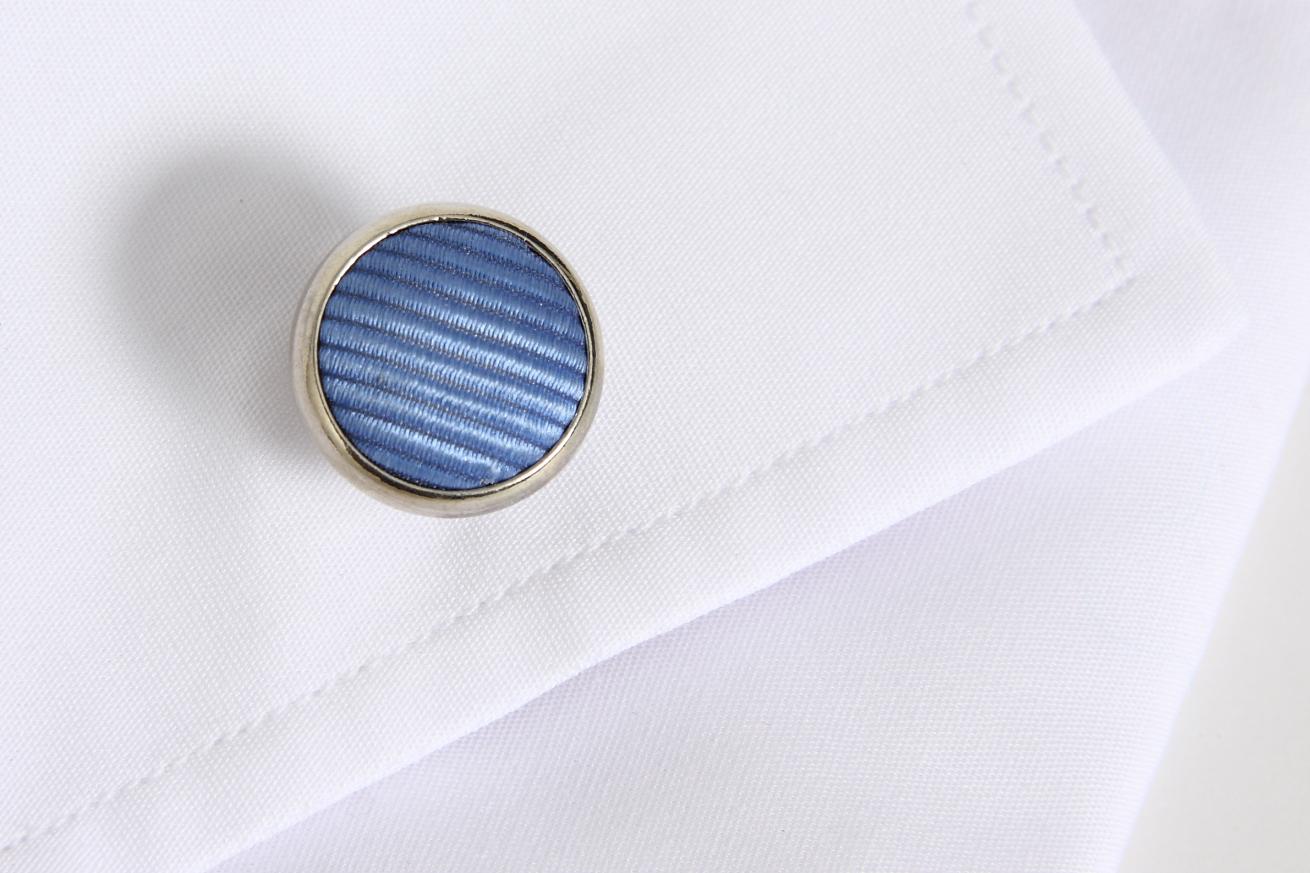 Botão de punho redondo com tecido